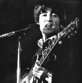 John Lennon on stage with his Epiphone guitar